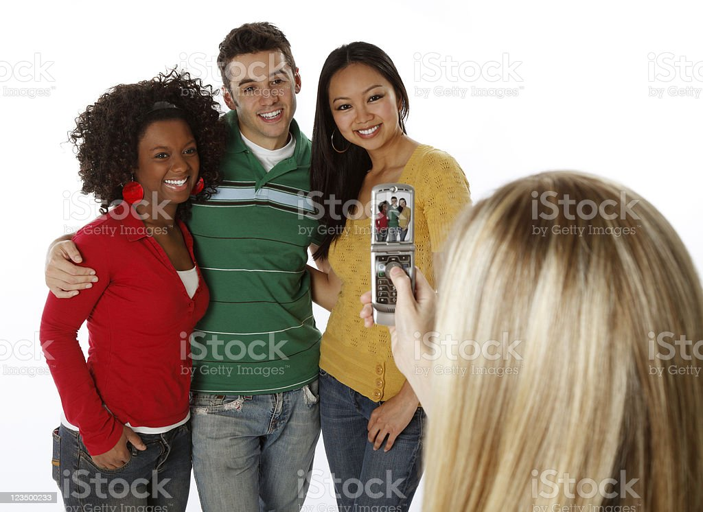 Friends Taking a Picture on Their Cell Phone royalty-free stock photo
