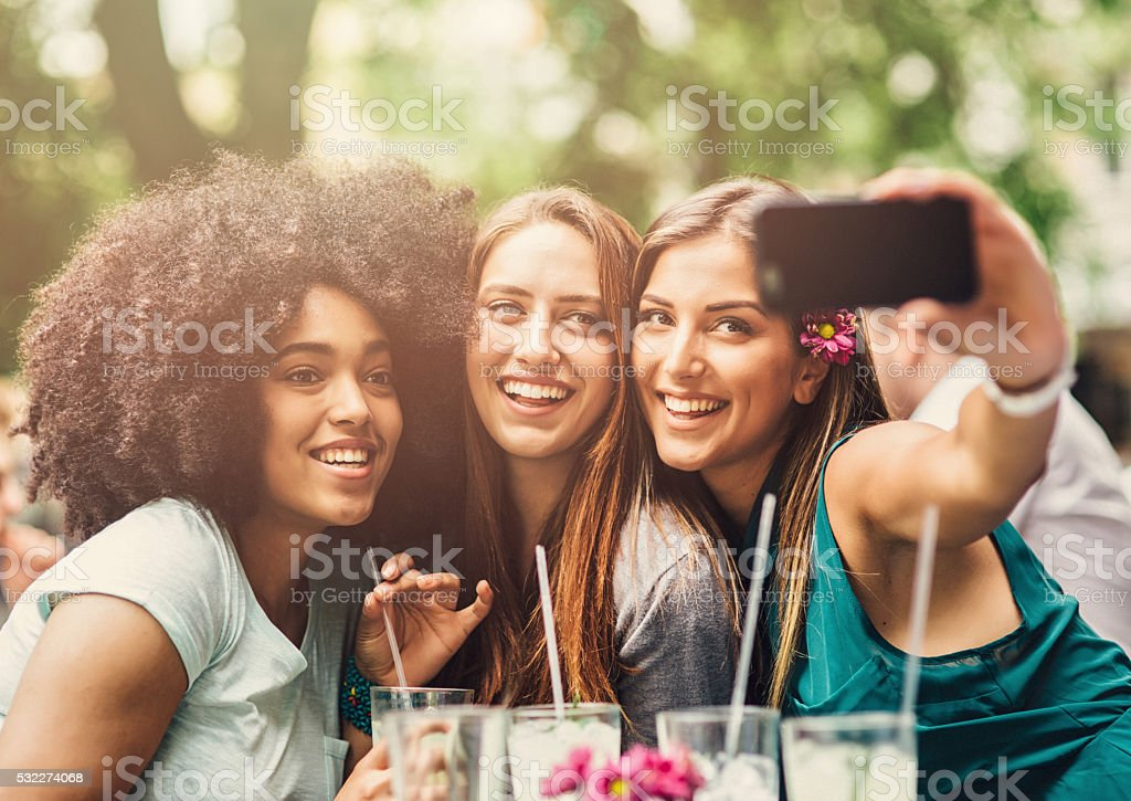Friends Taking A Selfie At The Cafe stock photo