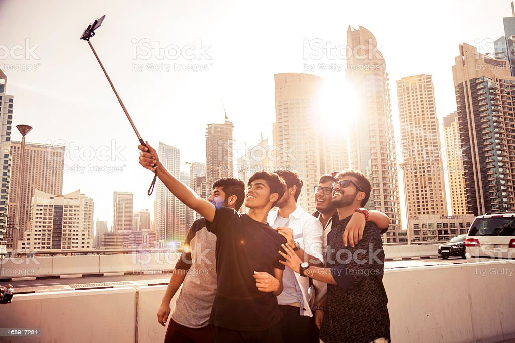 Friends taking a selfie in Dubai Marina during a vacation stock photo
