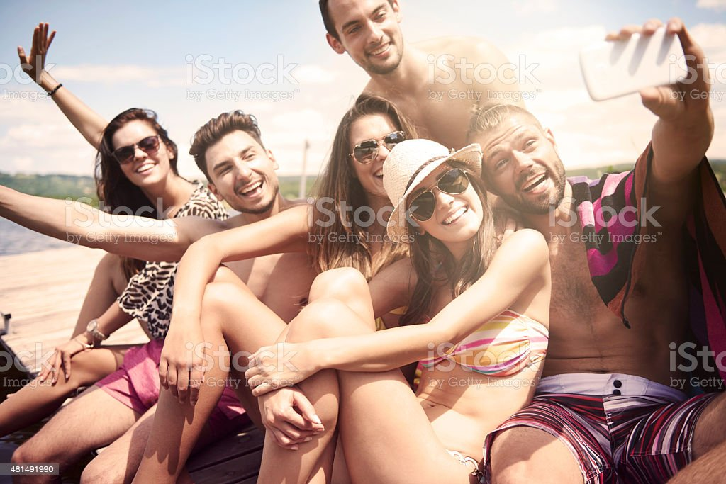 Friends taking a selfie on the beach stock photo
