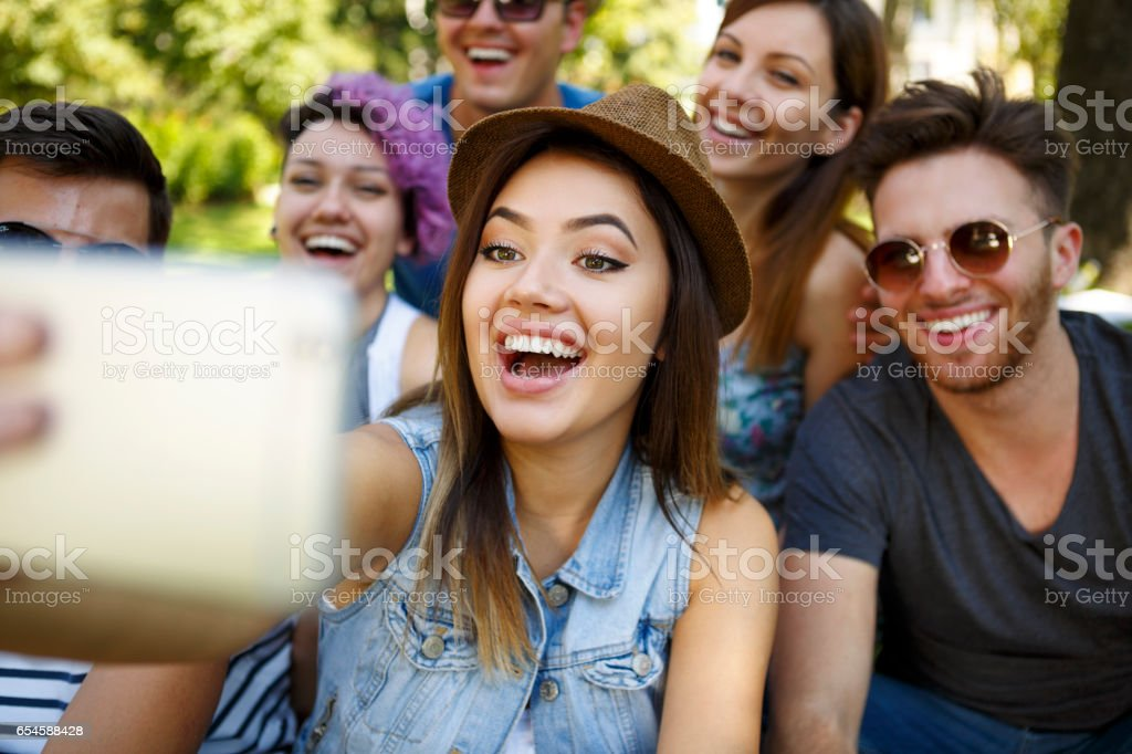 Friends taking a selfie outdoors stock photo