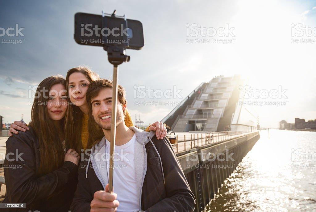 Friends taking a selfie stick in Hamburg stock photo