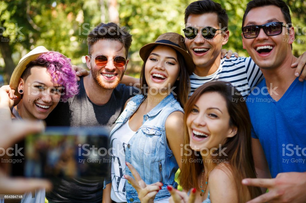 Friends taking photos of themselves stock photo