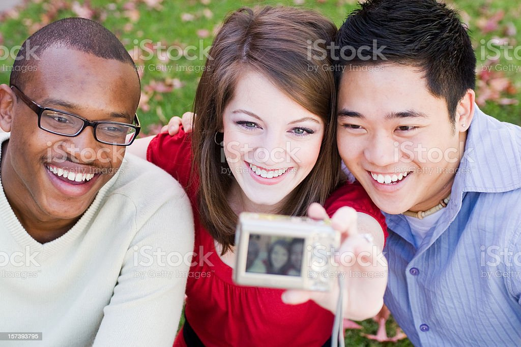 Friends Taking Pictures royalty-free stock photo
