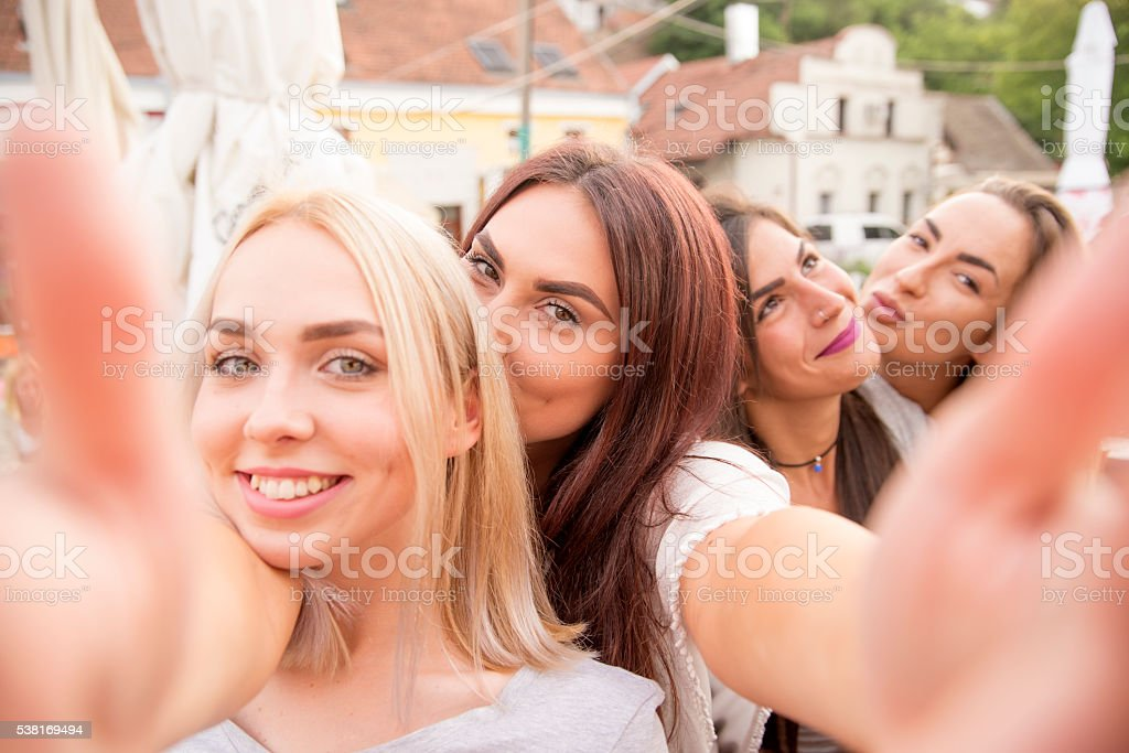 Friends taking selfie and having fun stock photo