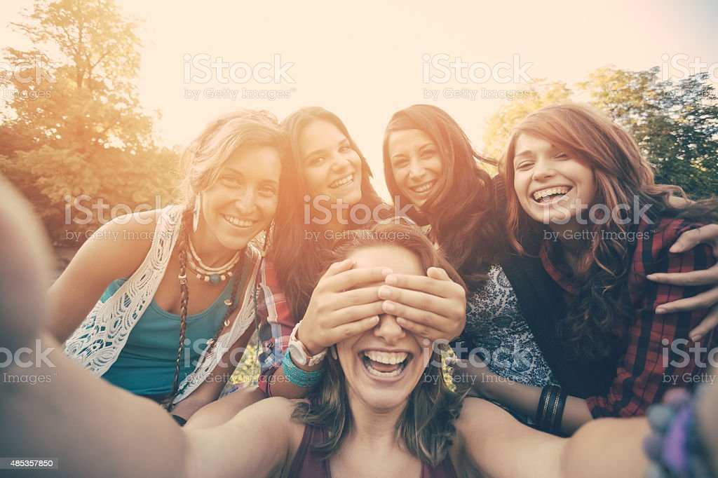 Friends taking selfie in the park stock photo