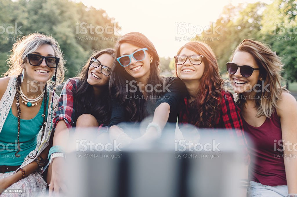 Friends taking selfie in the park stock photo
