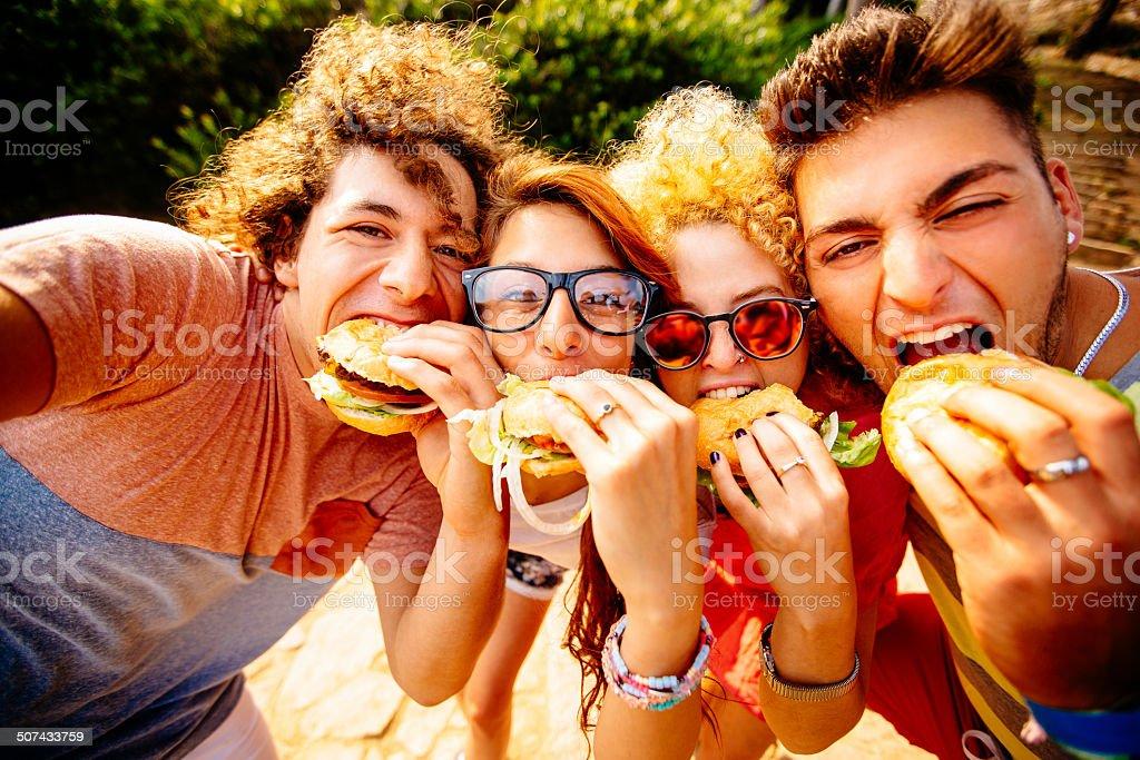 Friends Taking Selfie With Hamburgers stock photo
