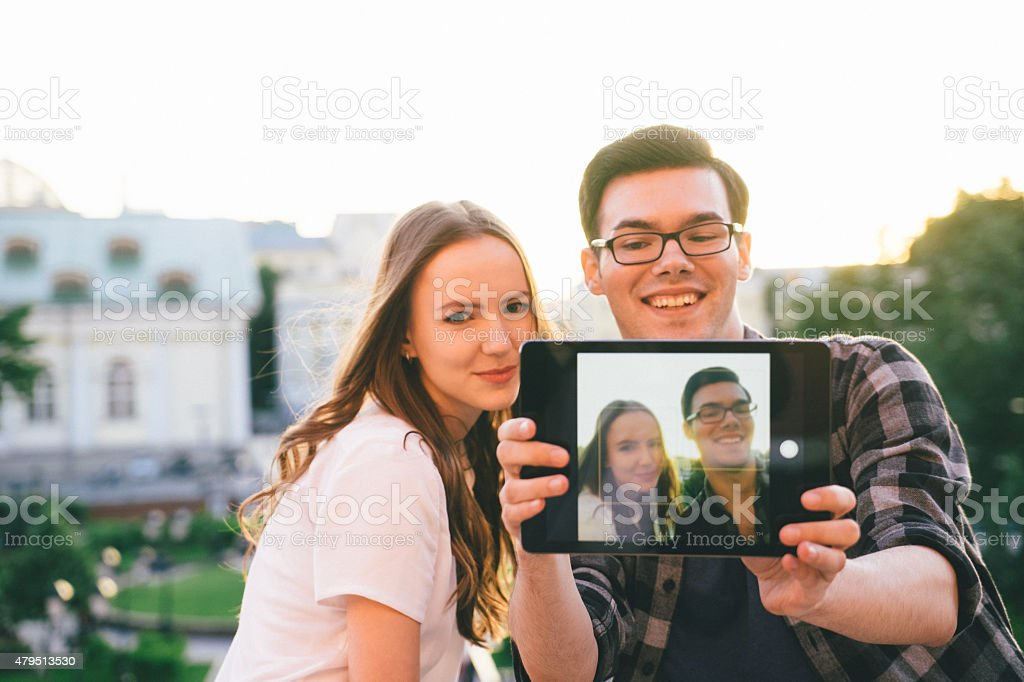 Friends Taking Selfies Outdoors stock photo