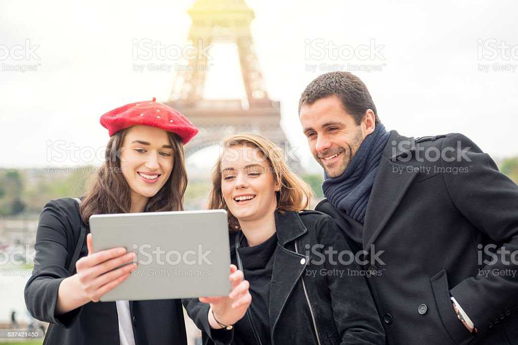Friends taking selfies stock photo