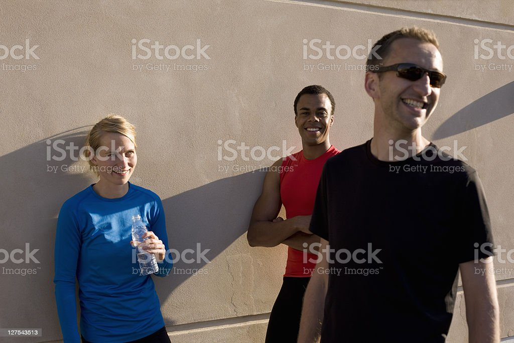 Friends talking after running together stock photo