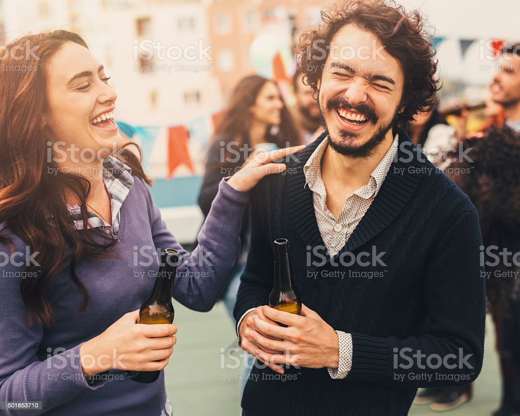 Friends Talking And Laughing At A Party stock photo