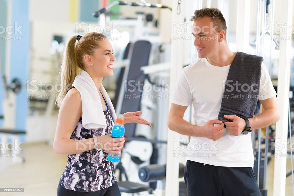 Friends talking at gym stock photo