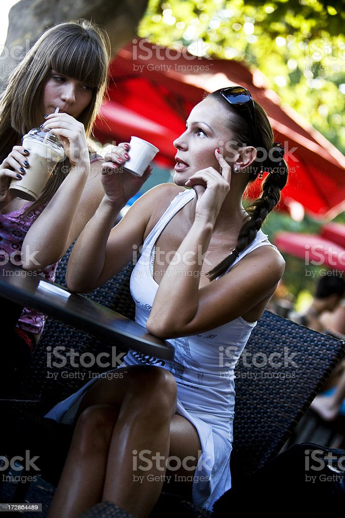 Friends talking in cafe royalty-free stock photo