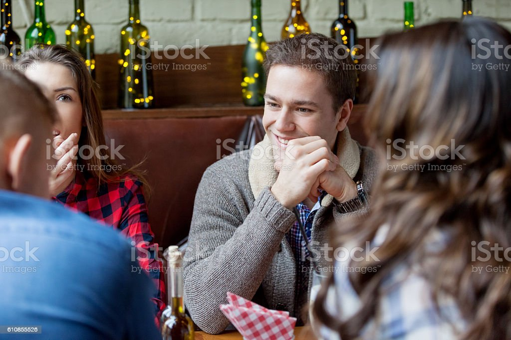 Friends talking in cafe stock photo