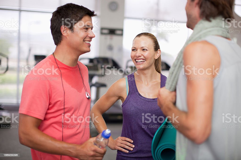 Friends talking in gymnasium royalty-free stock photo