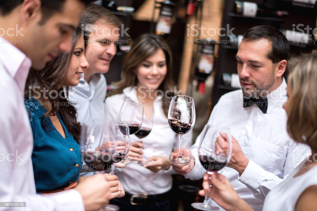 Friends tasting wine at a cellar stock photo