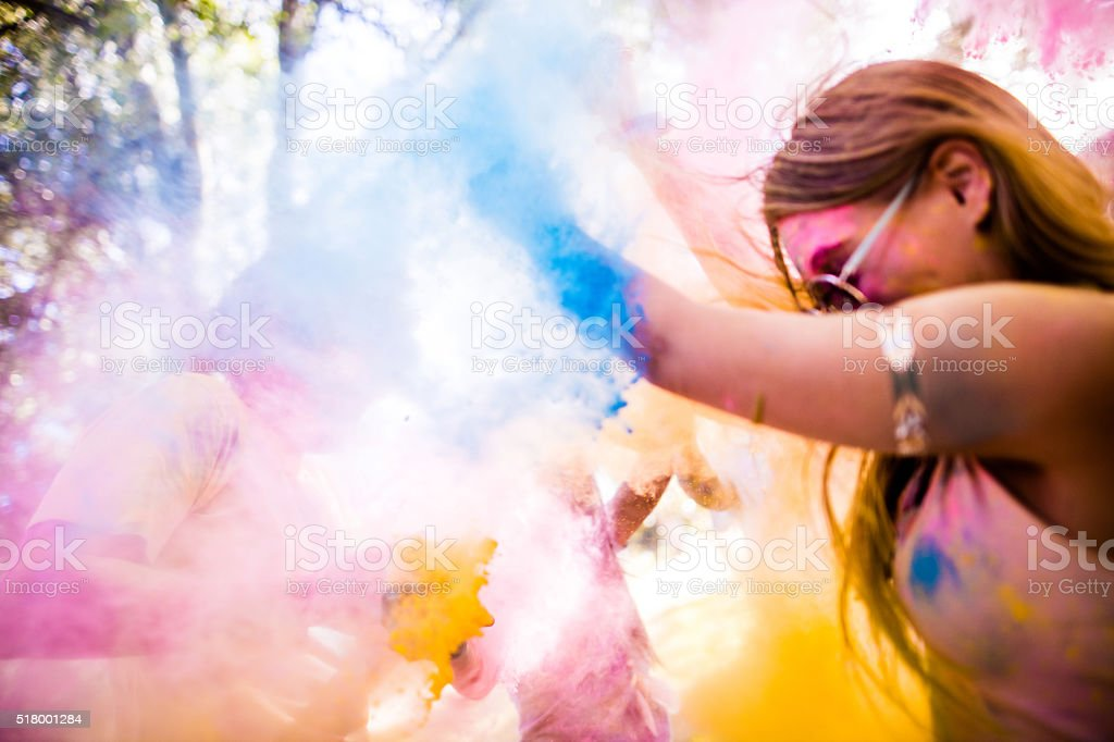 Friends Throwing Holi Powder at Each Other stock photo