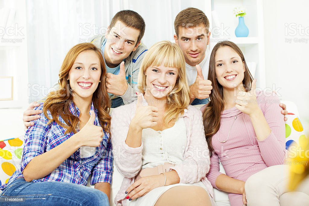 Friends Thumbs Up at home. royalty-free stock photo