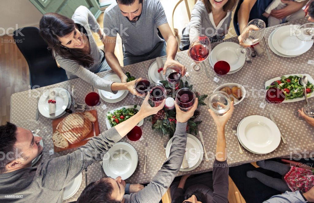 Friends toasting at Christmas dinner stock photo