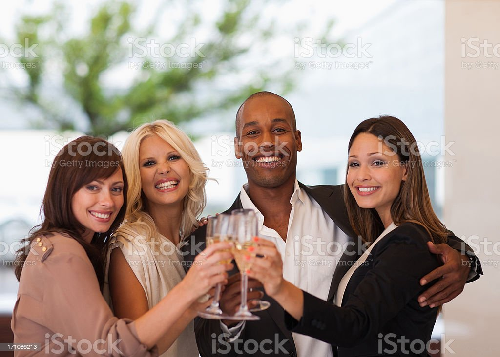 Friends toasting champagne flutes royalty-free stock photo