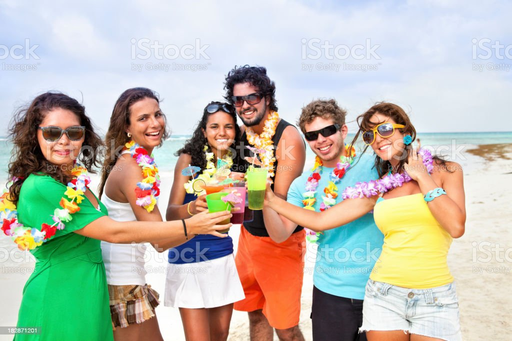 Friends toasting during beach party stock photo