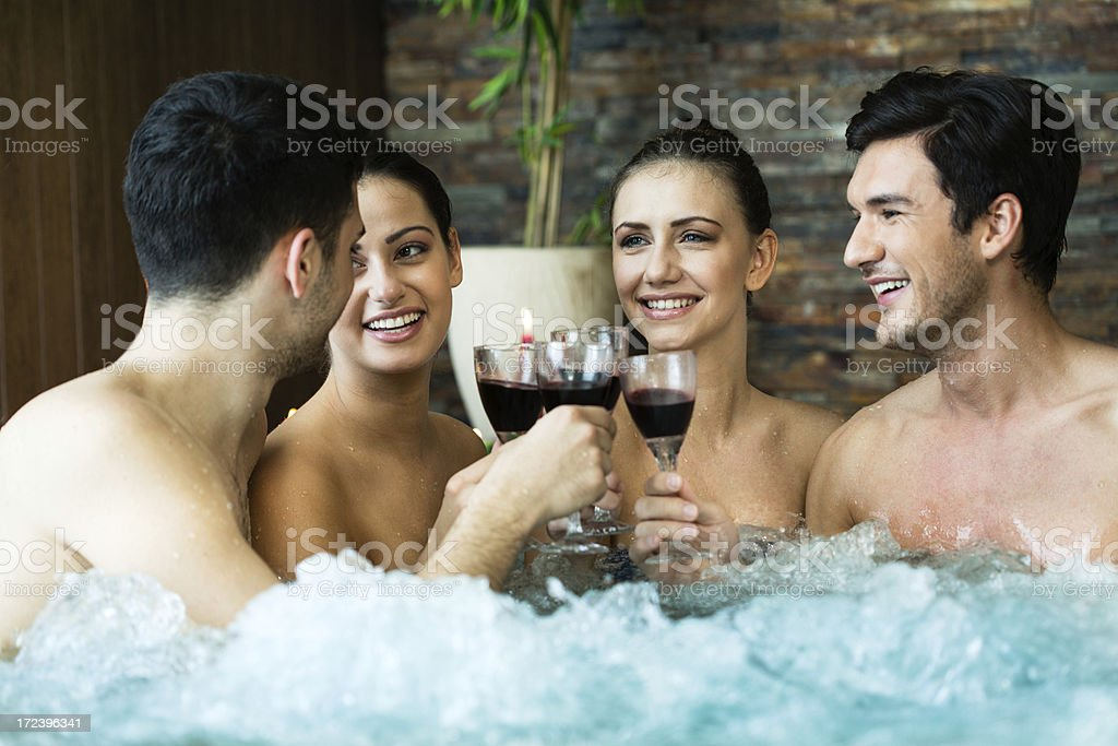 Friends toasting in jacuzzi royalty-free stock photo