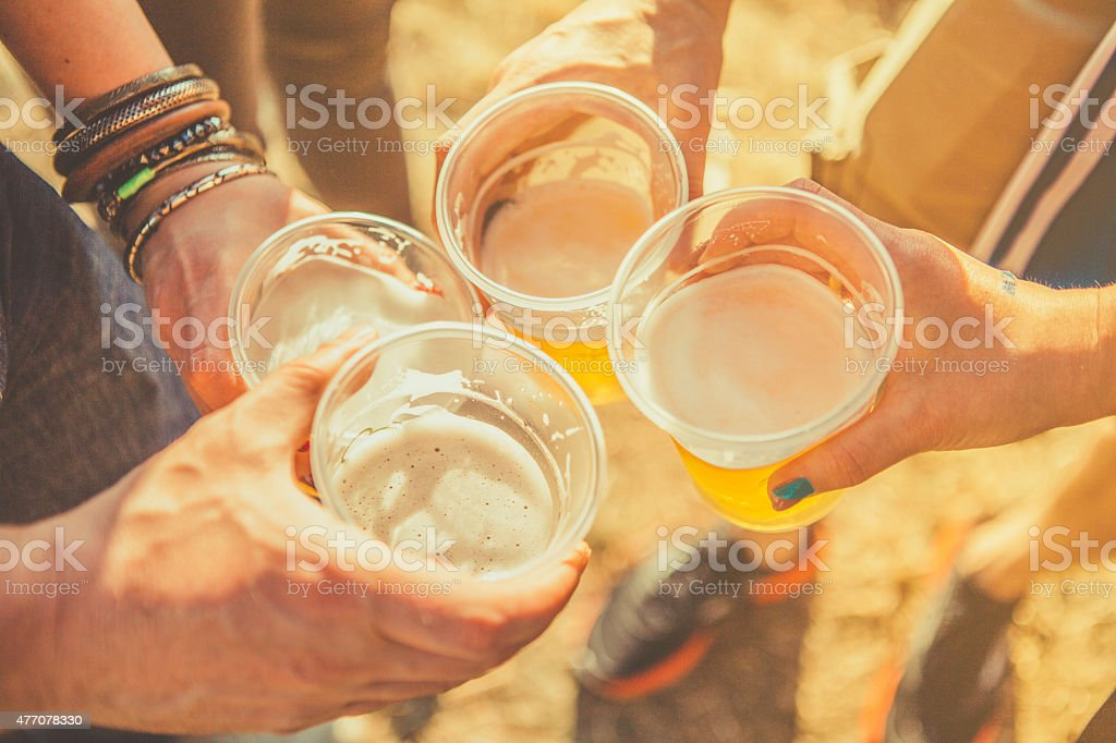 friends toasting with beer stock photo