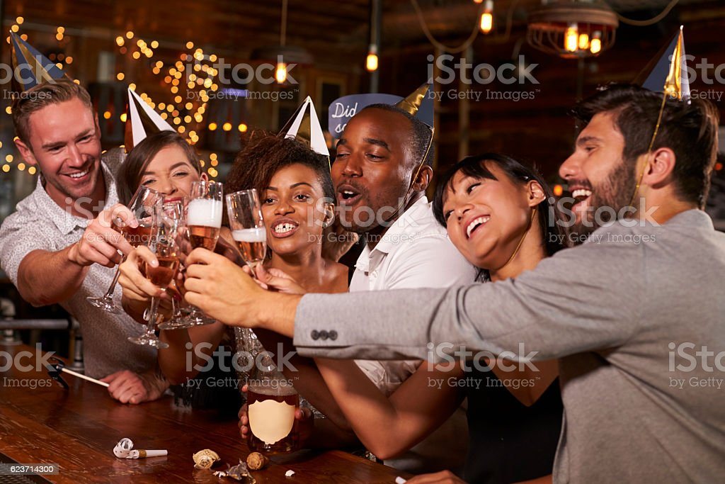 Friends toasting with champagne at New Year's stock photo