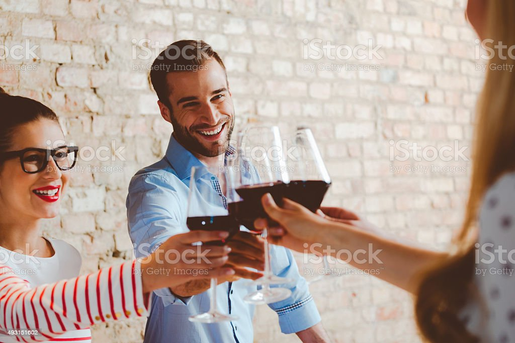 Friends toasting with red wine stock photo