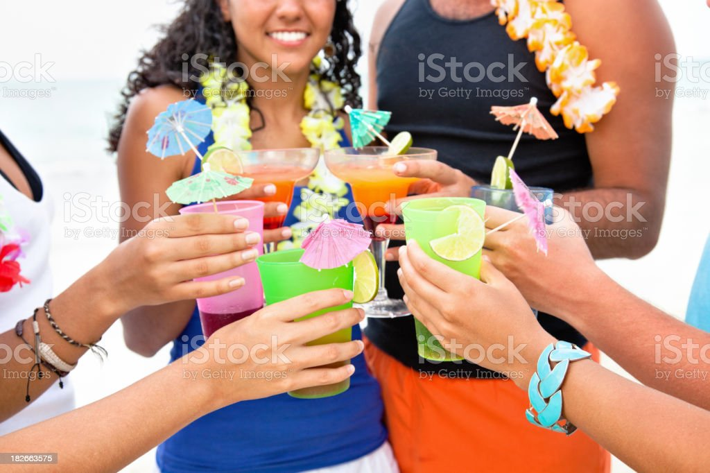 Friends toasting with tropical drinks stock photo
