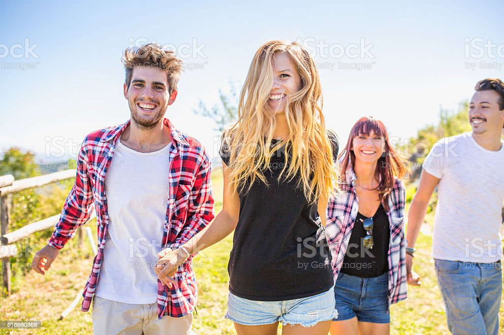 Friends together in outdoor nature stock photo