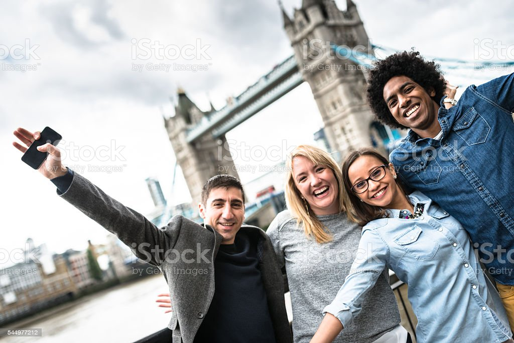 friends togetherness in london - Tower bridge stock photo