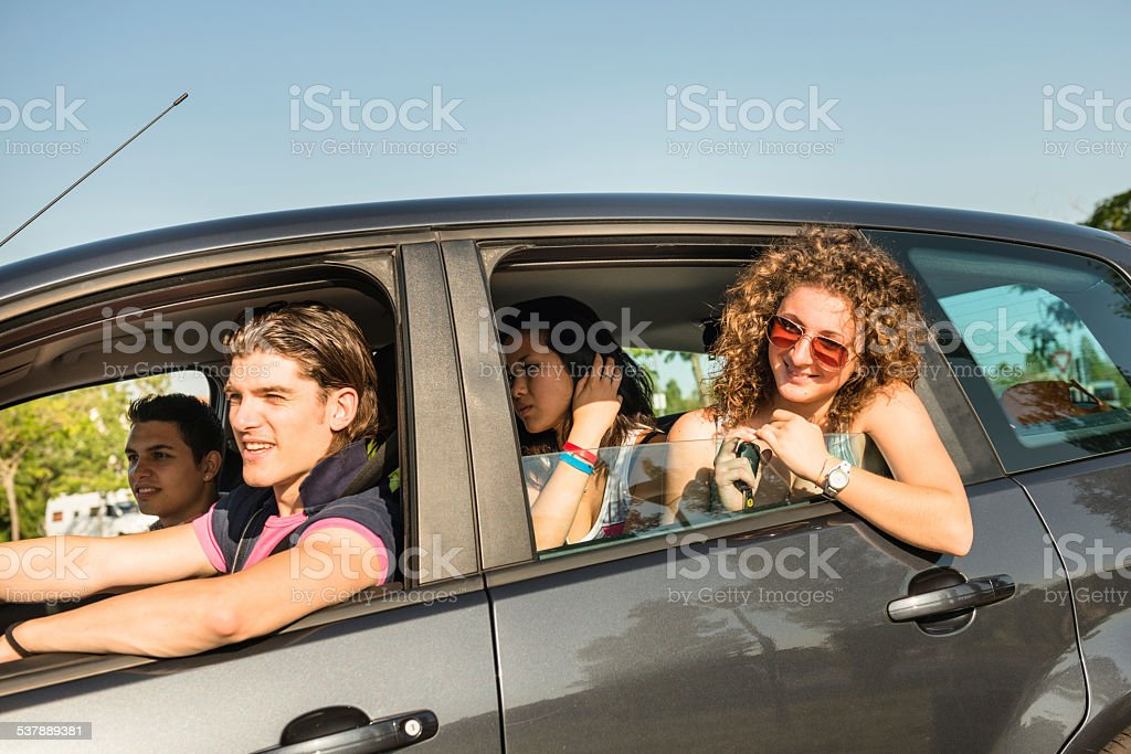 Friends togetherness on the car leaving for vacations stock photo