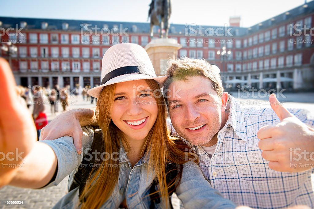 friends tourist couple visiting Spain on holidays taking selfie picture stock photo