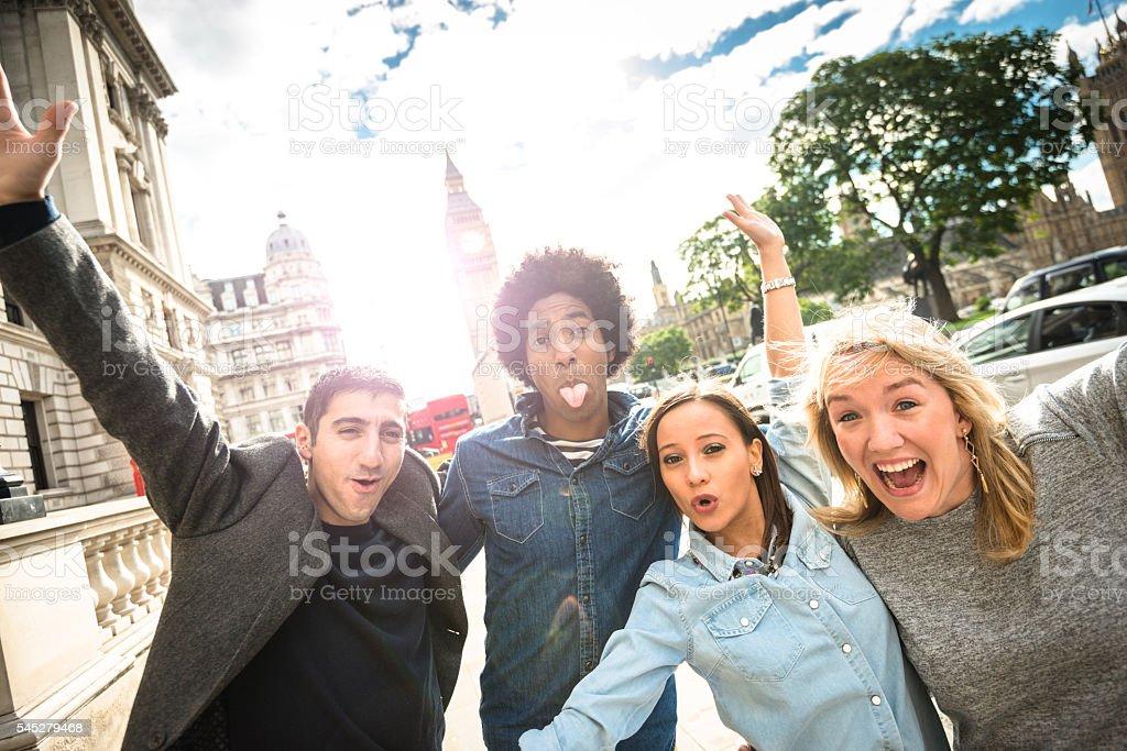 friends tourist have fun in london - big ben stock photo