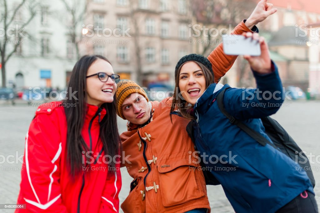 Friends traveling and taking photos stock photo