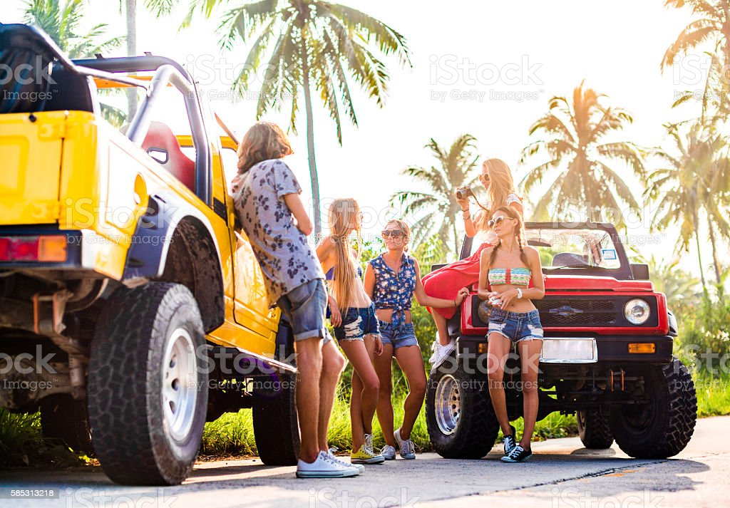 Friends traveling with 4x4 car in the jungle stock photo