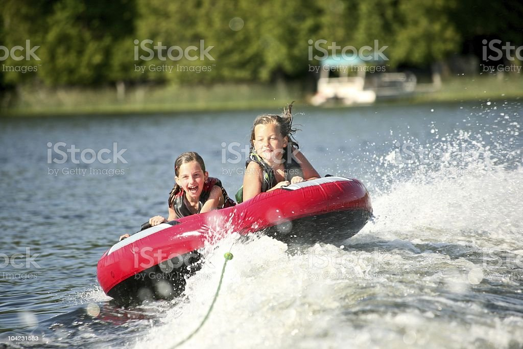 Friends Tubing on a Lake royalty-free stock photo