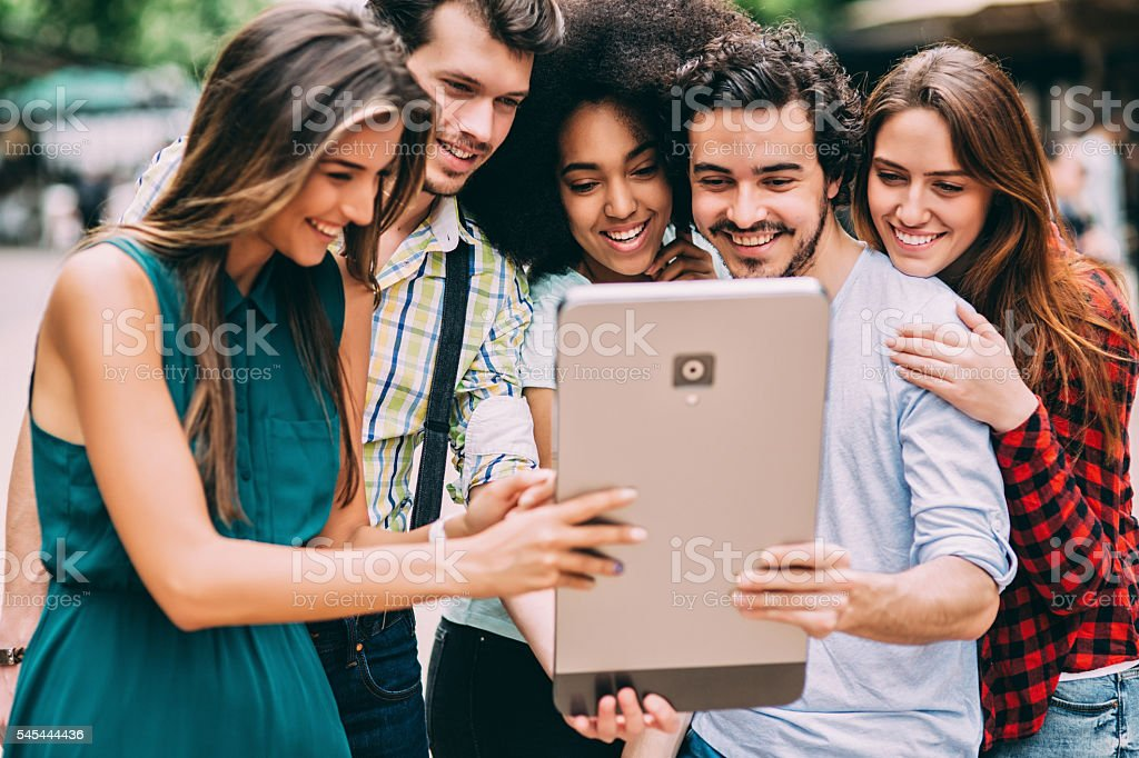 Friends using a large smart phone stock photo