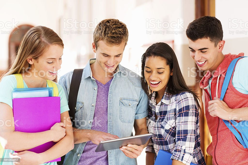 Friends Using Digital Tablet On Campus royalty-free stock photo