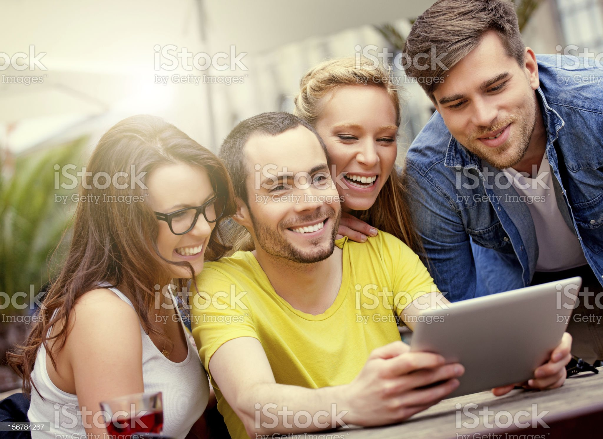 friends using digital tablet outdoors royalty-free stock photo