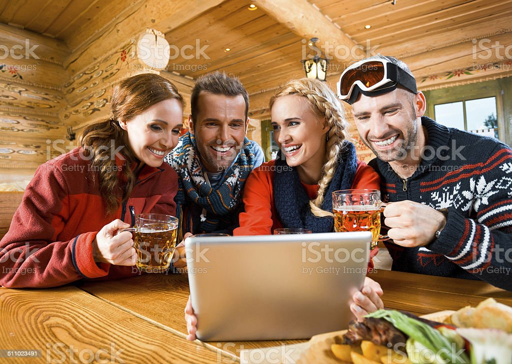 Friends using digital tablet stock photo