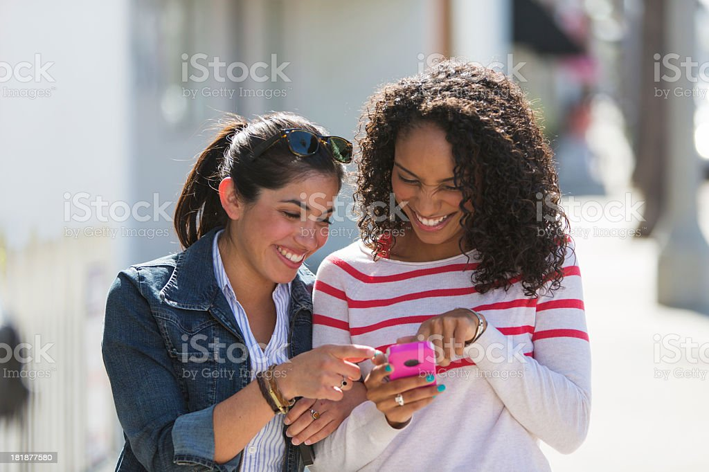Friends Using Phone royalty-free stock photo