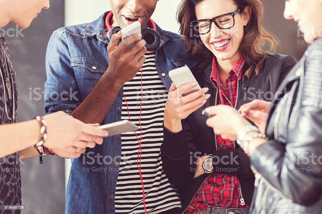 Friends using smart phones, close up of hands stock photo