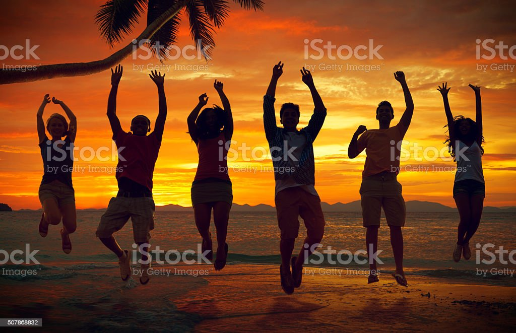Friends Vacation Sea Summer Jumping Shot Concept stock photo