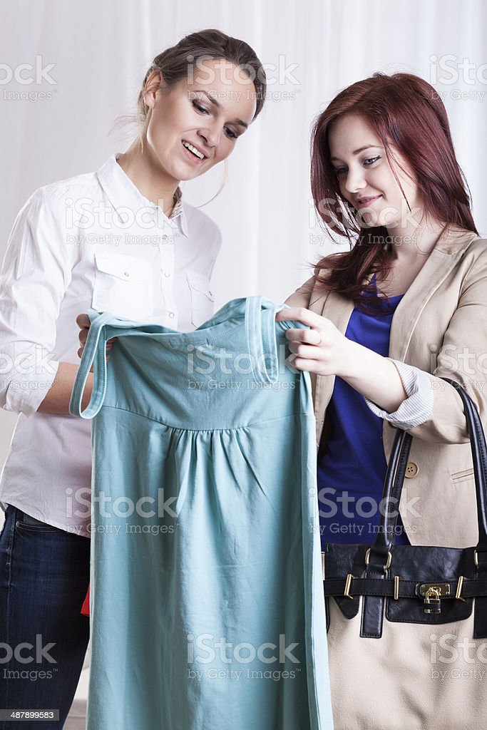 Friends viewing new dress royalty-free stock photo