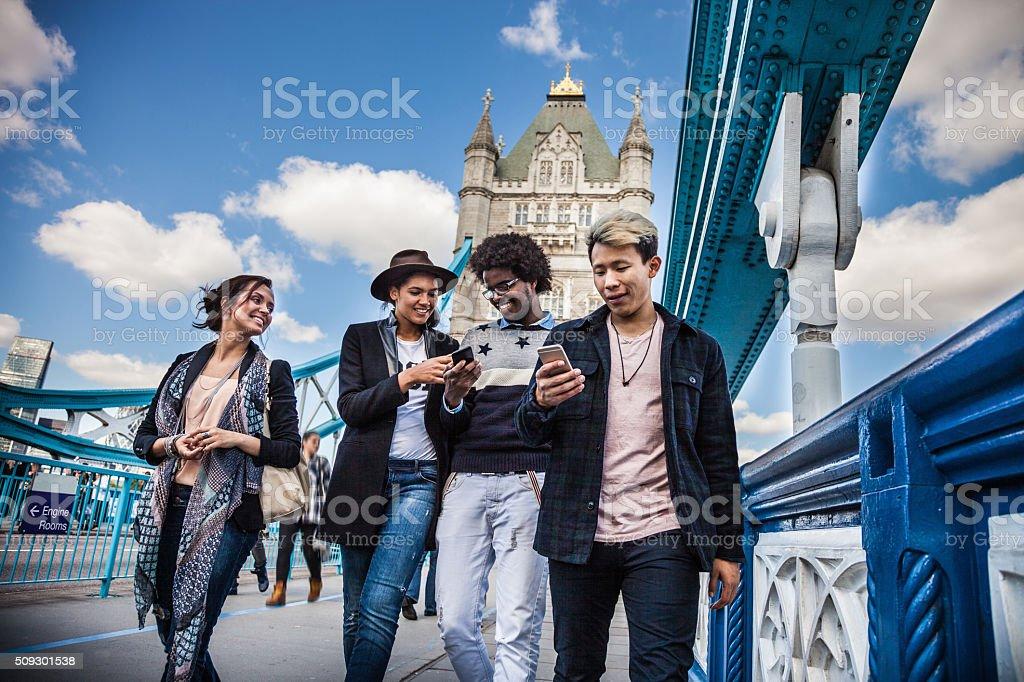 Friends walking around London landmarks stock photo