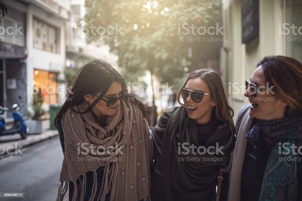 Friends walking in the city stock photo