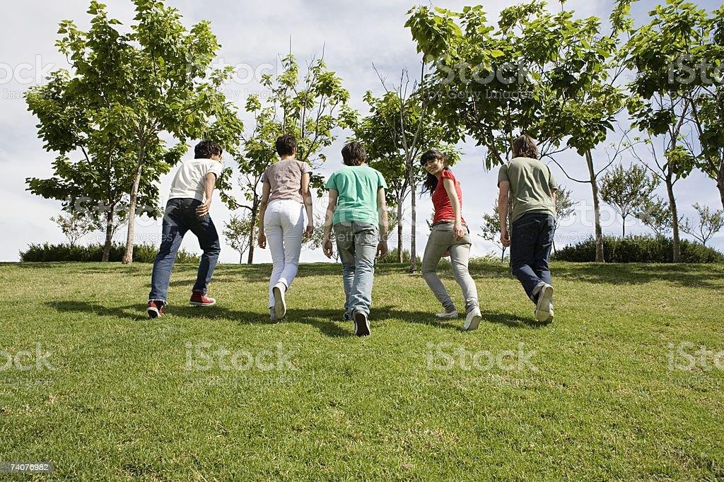 Friends walking up verge stock photo